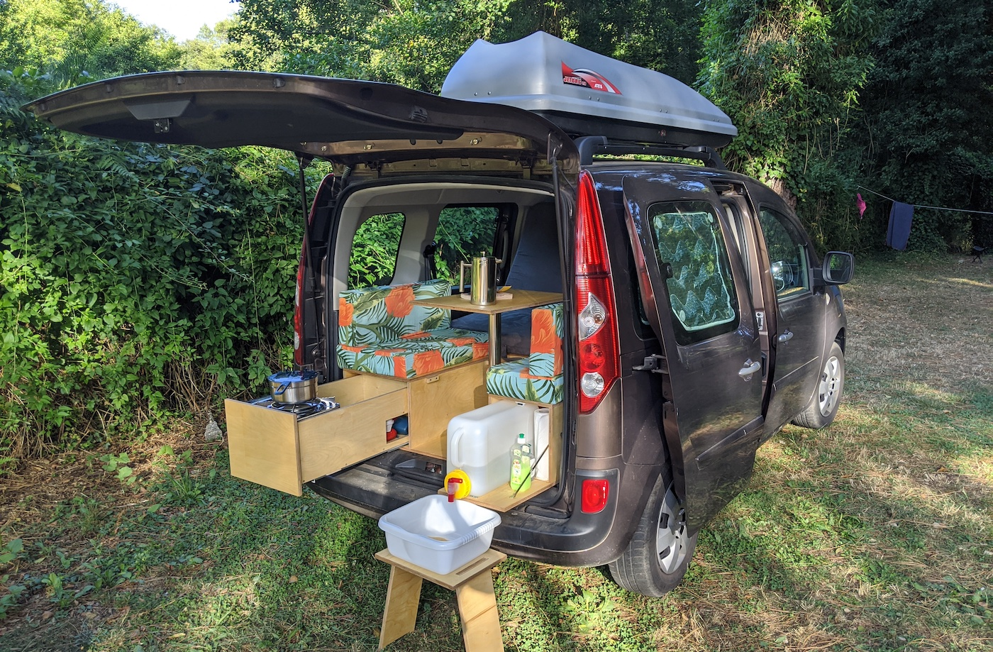 Our DIY camper van in a campsite in a beautiful nature setting