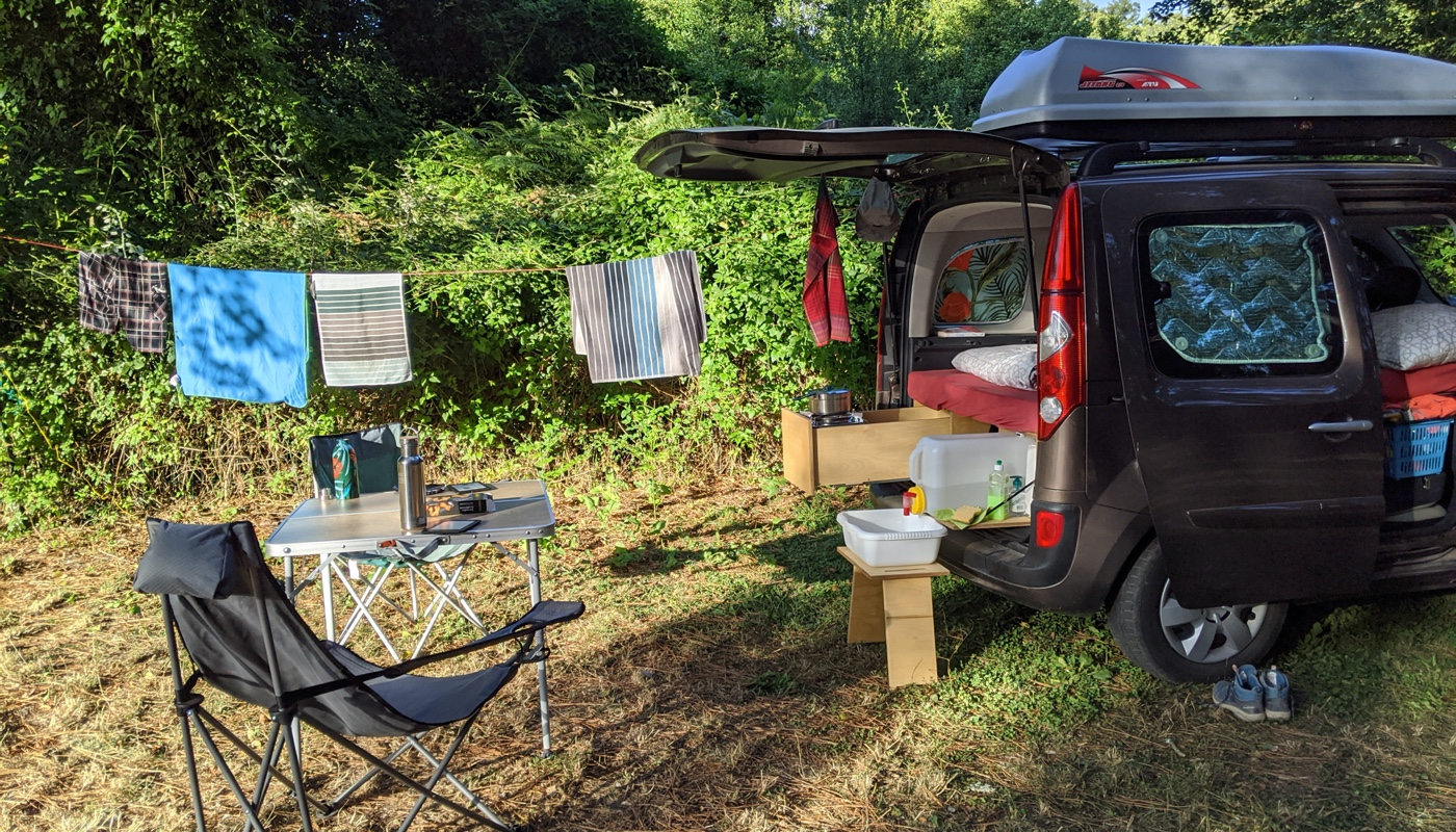 Camper van in a campsite in a beautiful nature setting